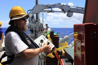 Al Duester from the AUV Sentry team, remotely controls Sentry from Falkor during the first open water test.
