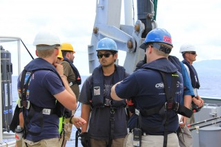 The Woods Hole Oceanographic Institute (WHOI) meet on the aft deck to debrief after Sentry trials.