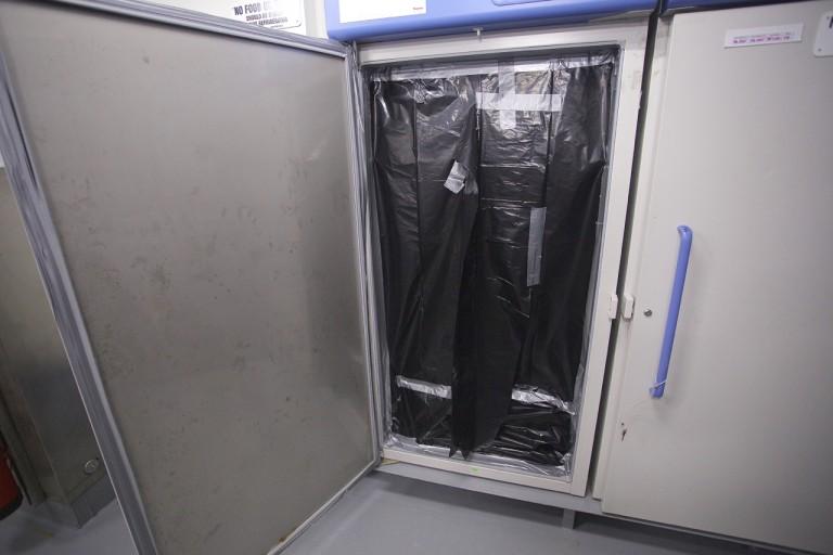 Refrigerator dark room constructed by artist Leslie Reed.