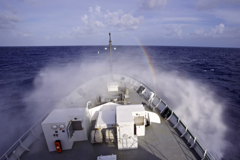 Rainbow in the mist off of the bow