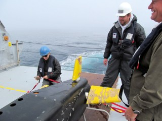 Researchers and crew aboard the Falkor secure the VPRII to the aft deck after a regularly scheduled launch and tow.