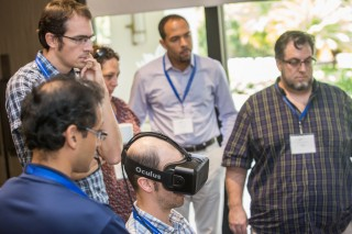 Workshop participants check out a virtual reality demonstration given by Dr. Oliver Kreylos.