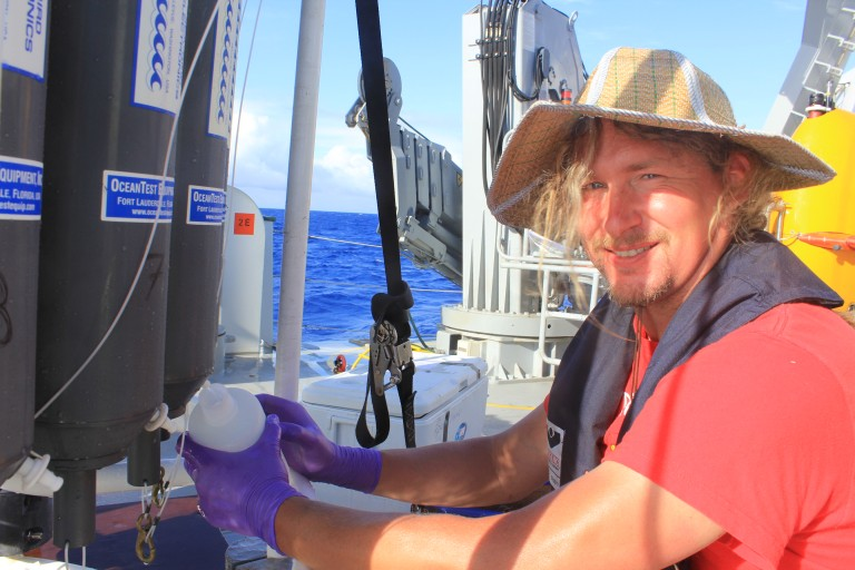 University of Hawaii post doctroal fellow Arne Sturm collectes seawater for Iron analysis.