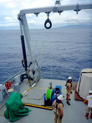 Deploying the magnetometer off Oahu.