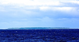 A view of Midway Atoll--from afar because the team's research permit for work in the strictly regulated monument does not allow launching of small boats or visits to the islands.