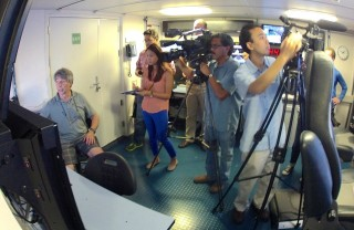 Chris Kelley explaining the expedition's accomplishments to the press in Honolulu.