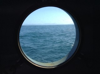 A view out the porthole as the RV Falkor steams to its first sampling station.
