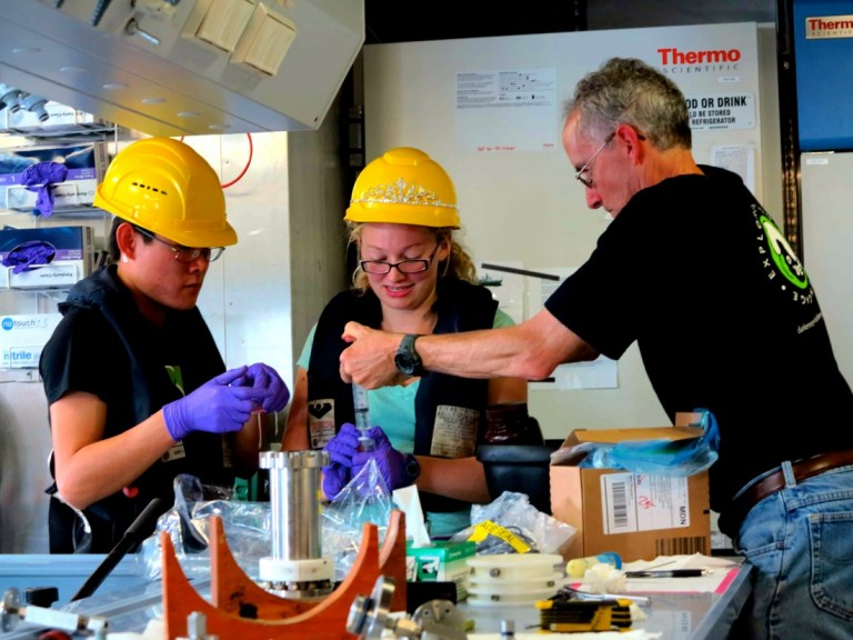 Processing newly collected water samples in the wetlab. From left to right: Than Kyaw, Bethany Kolody, and Doug Bartlett.