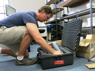 Dr. Jim Falter packing scientific equipment for the cruise.