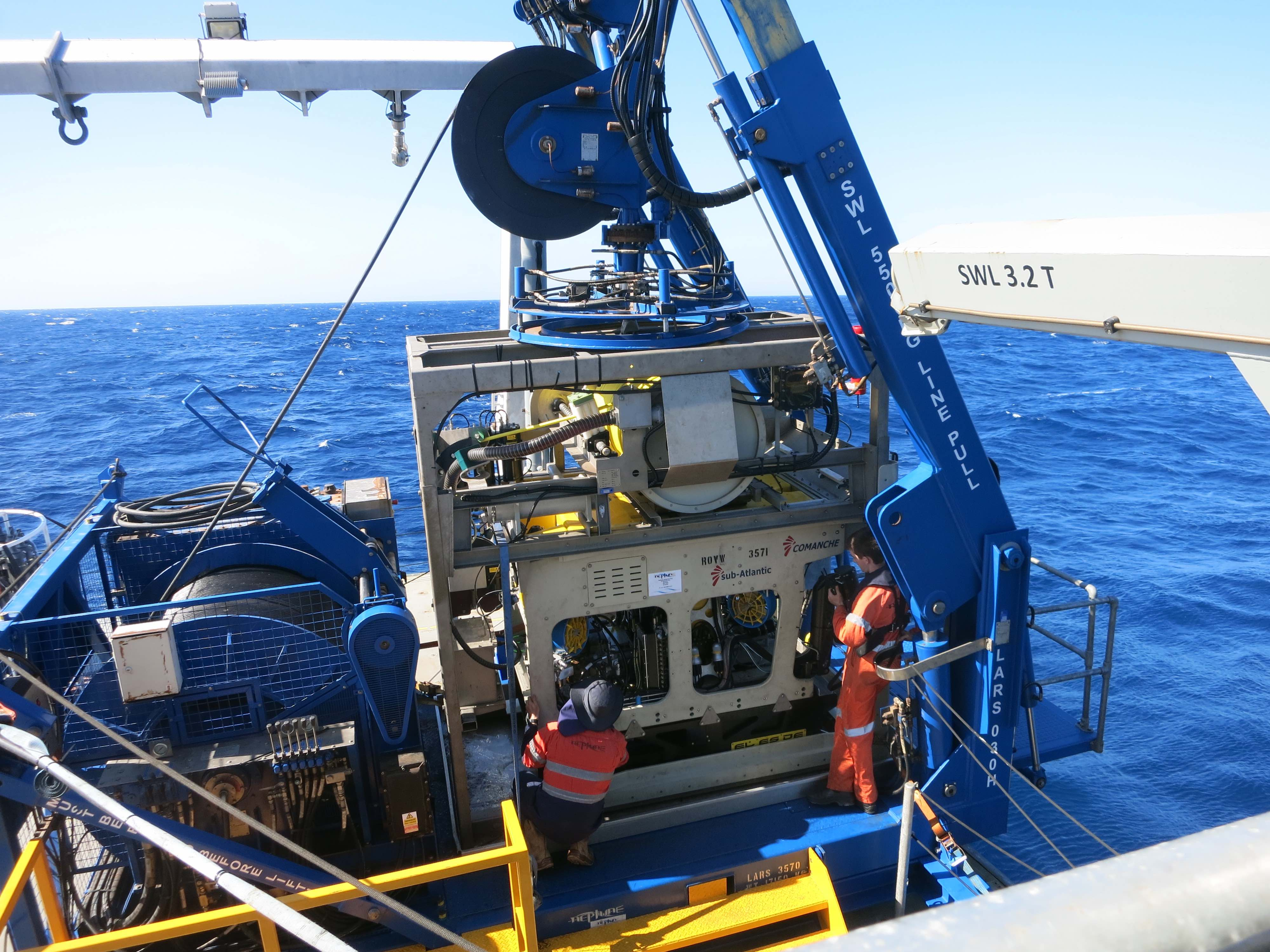 The ROV stationed on the Launch And Recovery System (LARS) aboard Falkor; getting prepped by technicians for the first test dive in the Perth Canyon.