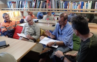 Science team meeting in the library (picturing Simon Spagnol, Greg Ivey, Richard Brinkman and Andrew Heyward).