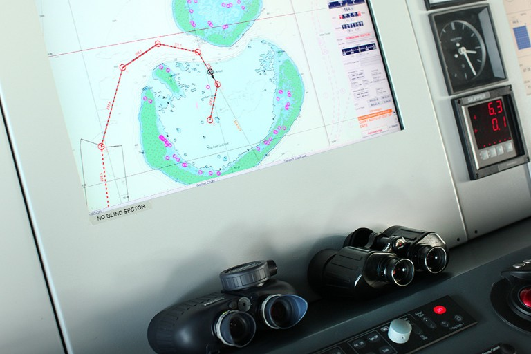 Binoculars and Digital navigational maps on the bridge as Falkor approaches its first destination at Scott Reef