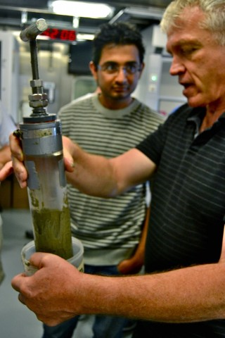 Andre Droxler (right) and Pankaj Khanna checking out one of several sediment cores collected with the ROV.