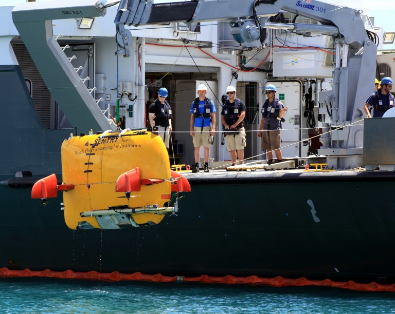 WHOI's Sentry team and SOI crew practice deploying the AUV Sentry off the aft deck of Falkor.