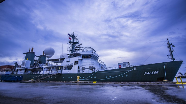 R/V Falkor prepares to begin the Hydrothermal Hunt research cruise under stormy skys in Guam.