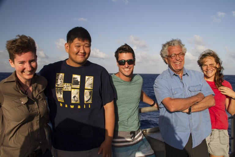 Lucy Bellwood, Andrew Kang, Brock Callen Jr. and Sr. and Jena Kline are onboard Falkor to learn about multibeam mapping and assist resident Marine Technicians when mapping the remote Johnston Atoll.