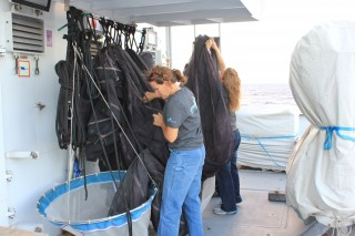Chief scientist Erica, packs up the nets from the MOCNESS.