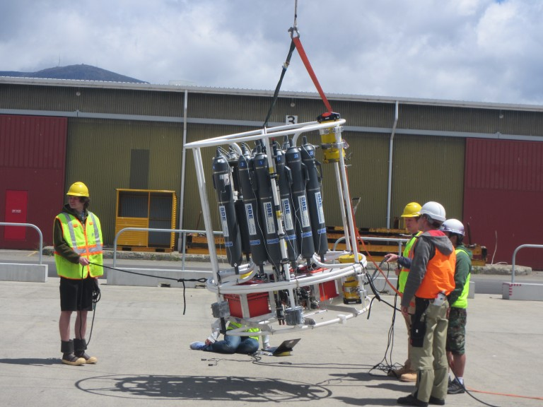 Science and ship crew tilt and twirl the CTD rosette to calibrate the LADCP.