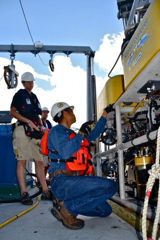 ROV engineer Toshi Mikagawa preps the Global Explorer for the first dive.