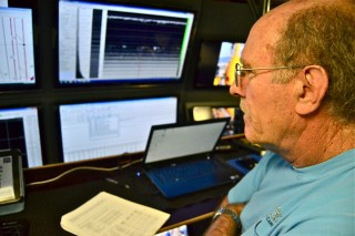 Wes Tunnell watches as the sonar system does its magic.