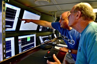 Wes Tunnell (right), a lead scientist, and marine technician Nathan Cunningham (left) at the multibeam sonar mapping station.