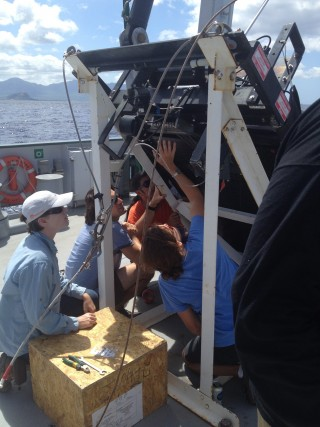 The science team and Falkor crew work diligently on setting up the MOCNESS for the first plankton tow of the cruise.