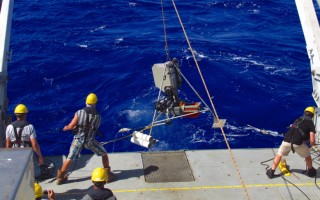 Retrieving the hadal video lander with its tubular amphipod traps from the Sirena Deep.