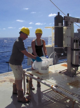 Water from the Sirena Deep. Dr Stuart Piertney and Chloe Weinstock retrieve water collected with the SOI Rock Grabber Lander from the Sirena Deep, 35,000 ft.